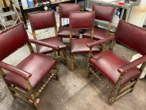 Leather dining chairs sympathetically restored